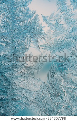 Beautiful Closeup Winter Window Pane Coated Shiny Icy Frost Patterns  - stock photo