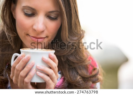 Beautiful closeup woman drinking coffee - stock photo
