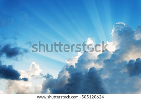 beautiful cloud on blue sky with light rays. subject is blurred and low key