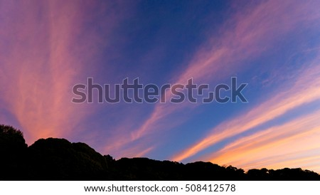 Beautiful clouds and sky with silhouette of the mountain.