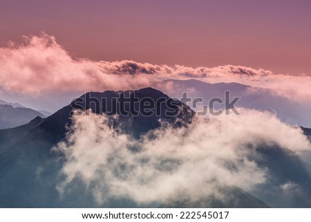Beautiful clouds at sunset in the Alps