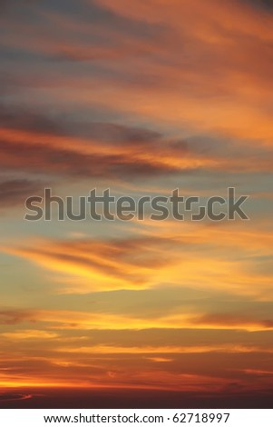 Beautiful clouds at sunset on the beach - stock photo