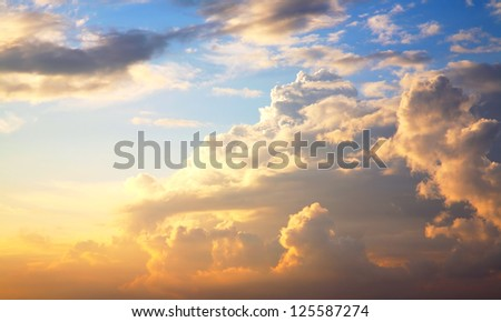 beautiful clouds on sunset sky - stock photo