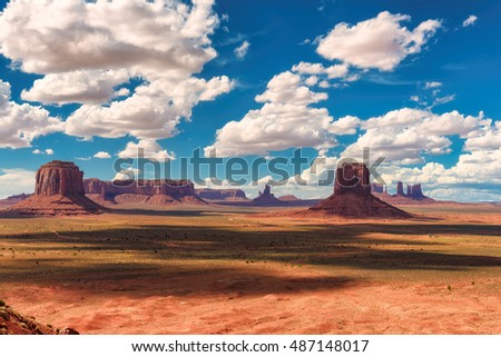 Beautiful clouds over the Monument Valley, desert canyon in USA