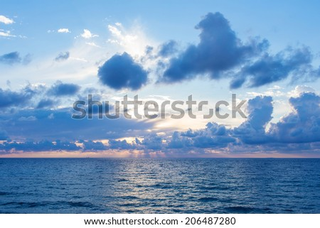 Beautiful clouds over the sea - stock photo