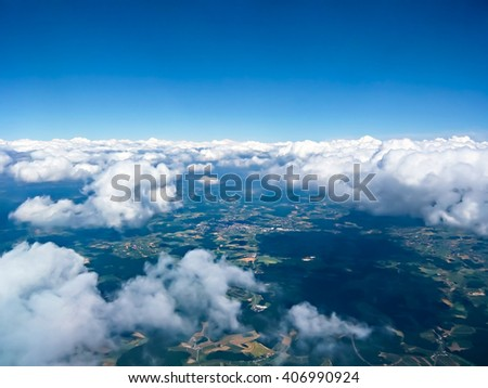 Beautiful cloudscape in the sky. Photo was made on high altitudes. There are remote lands above the clouds. - stock photo