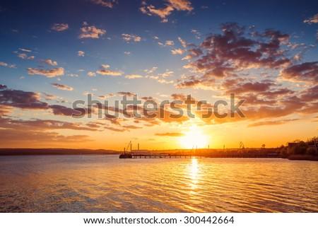 Beautiful cloudscape over the lake, sunset shot - stock photo