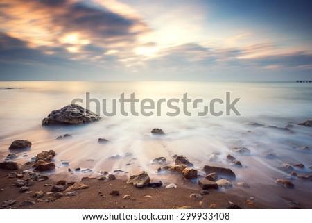 Beautiful cloudscape over the sea, sunrise shot - stock photo