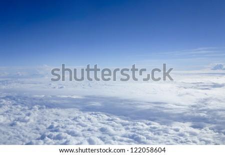 Beautiful Cloudscape through flight window - stock photo