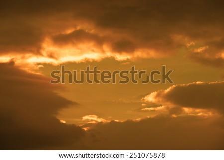 beautiful cloudy orange sunset sky in the wild Atlantic way, Ireland with sunbeams - stock photo