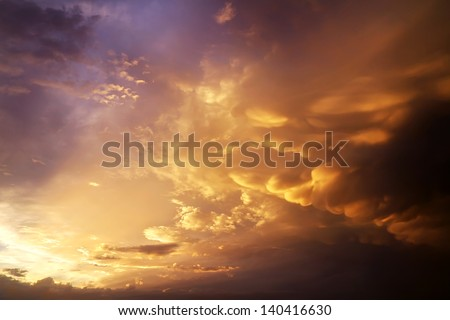 Beautiful cloudy sky with sun rays. Cloudy abstract background. Sunset light. - stock photo