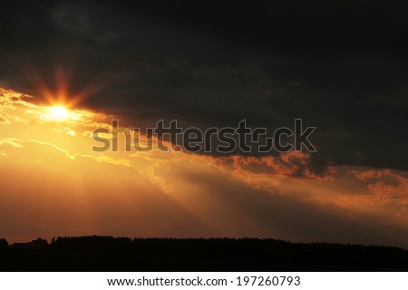 Beautiful cloudy sky with sun rays. Cloudy abstract background. Sunset light.