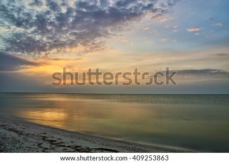 Beautiful cloudy sunrise at sea landscape
