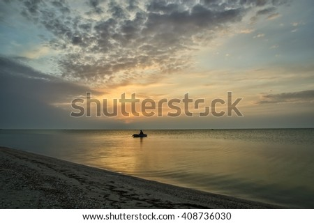 Beautiful cloudy sunrise at the seaside - stock photo