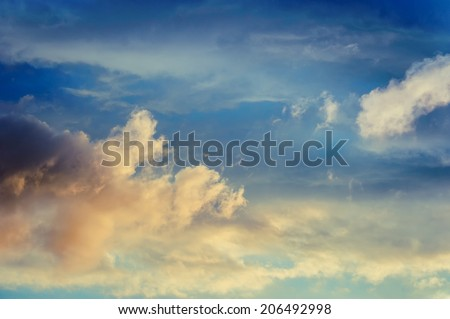 Beautiful cloudy sunset sky with light rays. Cloudy abstract background. - stock photo