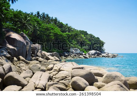 Beautiful coast of the Andaman Sea, covered with forests - stock photo