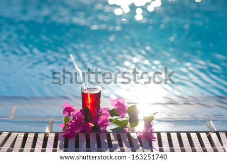 beautiful cocktail on the pool - stock photo