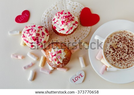 Beautiful coffee Cup with heart cupcake on white wooden background