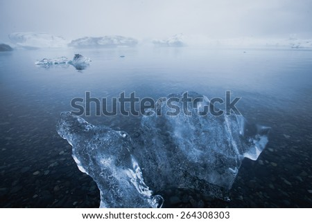 Beautiful cold landscape picture of icelandic glacier lagoon bay with ice and glacier, arctic landscape, antarctic landscape with melting glaciers, frozen lake, greenland