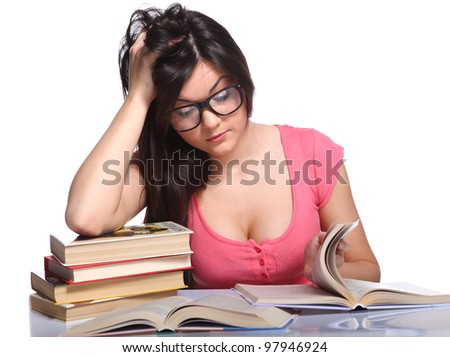 Beautiful college girl sitting in glasses and holding book - stock photo