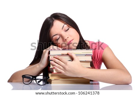 Beautiful college girl sleeping and holding books - stock photo