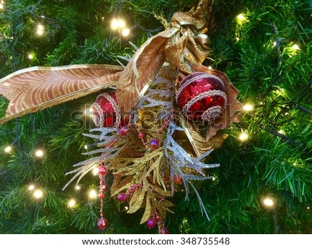 Beautiful color christmas decorations hanging on christmas tree with shiny glare - stock photo