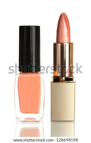 Beautiful color lipstick and nail polish isolated on white