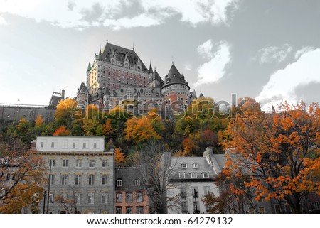 Beautiful color manipulated architectural chateau building in Quebec City, in the province of Quebec, Canada, with fall trees in the foreground - stock photo