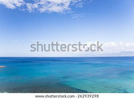 Beautiful colored sea. On the horizon are visible sailboat and motorboat. Polis, Cyprus.