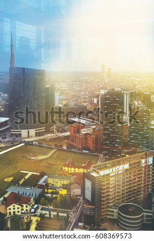 Beautiful colored toned aero view image of Milan, Italian urban cityscape with skyscrapers and different buildings on the streets and background with the sunset