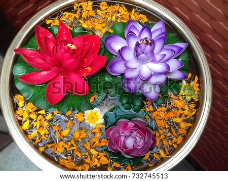 Beautiful colorful artificial flowers kept in rounded water Tub for decoration