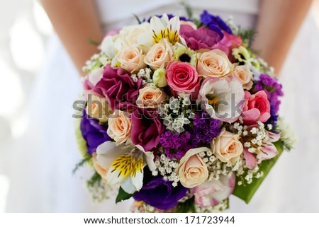 beautiful colorful bouquet in hands of the bride  - stock photo