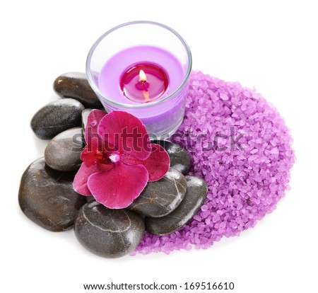 Beautiful colorful candles and orchid flower, isolated on white
