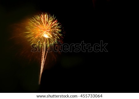 Beautiful colorful firework isolated display for celebration happy new year and merry christmas on black isolated background - stock photo