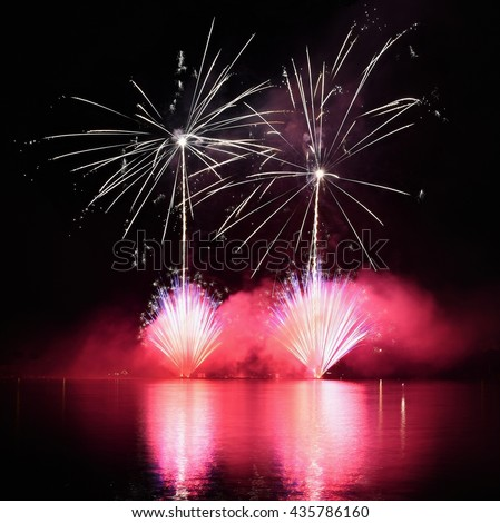 Beautiful colorful fireworks on water. Brno dam. Reflections on the water surface. International Fireworks Competition Ignis Brunensis.  - Czech Republic - Europe. - stock photo
