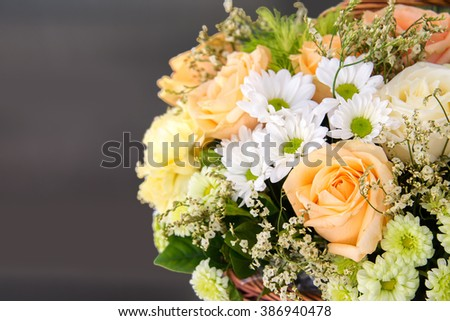 Beautiful colorful flowers in basket with copy space - stock photo