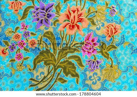 Beautiful colorful flowers pattern on batik background - stock photo