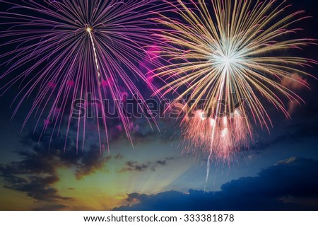 Beautiful colorful holiday fireworks in the evening sky and copy space. - stock photo