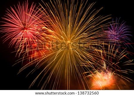 Beautiful colorful holiday fireworks on the black sky - stock photo