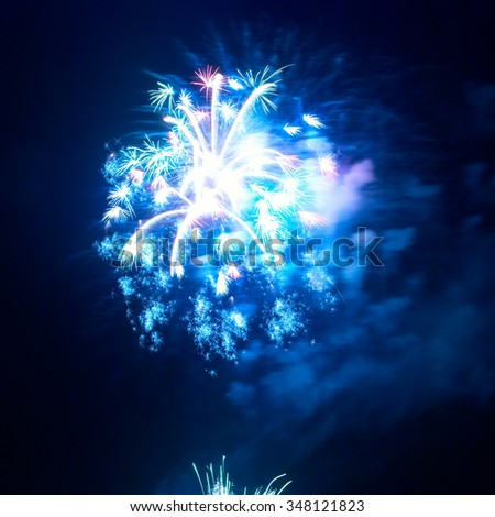 Beautiful colorful holiday fireworks on the black sky background