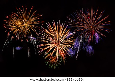 Beautiful colorful holiday fireworks on the night sky background, long exposure - stock photo