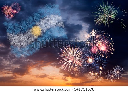 Beautiful colorful holiday fireworks with national flag of Argentina, evening sky with majestic clouds