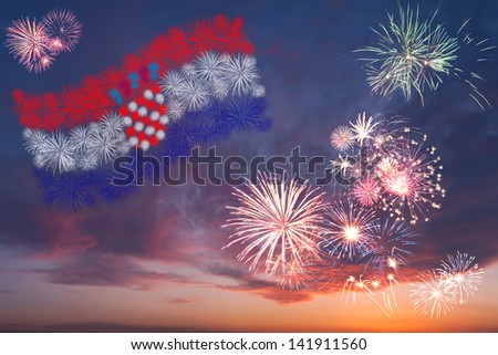 Beautiful colorful holiday fireworks with national flag of Croatia, evening sky with majestic clouds