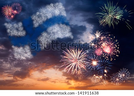 Beautiful colorful holiday fireworks with national flag of Finland, evening sky with majestic clouds