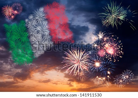 Beautiful colorful holiday fireworks with national flag of Italy, evening sky with majestic clouds - stock photo