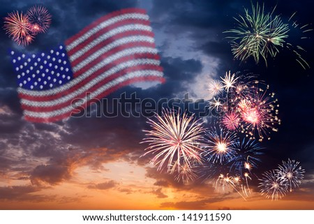 Beautiful colorful holiday fireworks with national flag of USA, evening sky with majestic clouds - stock photo
