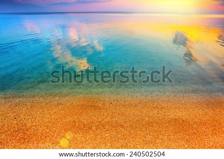 Beautiful colorful magic sunrise over beach - stock photo