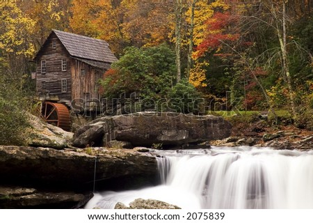 Beautiful colorful October autumn colors surround the Glade Creek Grist mill in West Virginia.