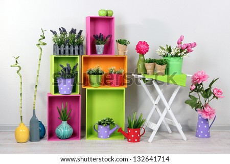 Beautiful colorful shelves with decorative elements standing in room - stock photo