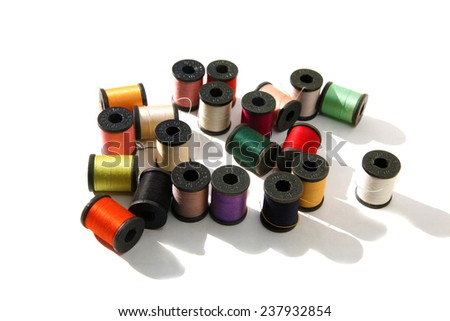 Beautiful Colorful spools of thread isolated on white with room for your text. Thread is used around the world to sew things together to keep people clothed and warm and in the latest fashion - stock photo